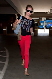 "Rebecca headed out from LAX in a pair of bright red ""811"" mid-rise skinny jeans."