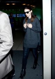 Rooney Mara looked cozy in a gray crewneck sweater while catching a flight.