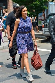 Rosario Dawson stepped out in a blue floral dress that was just right for summer.