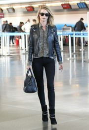 Rosie Huntington-Whiteley went for an edgy airport look with this black Saint Laurent leather jacket and skinny jeans combo.