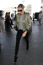 Rosie Huntington-Whiteley flew out of LAX wearing an olive-green Saint Laurent bomber jacket and a pair of ripped skinny jeans.