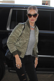 Rosie Huntington-Whiteley accessorized with a pair of oversized cateye sunnies by Stella McCartney for a flight out of LAX.