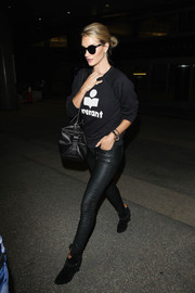 Rosie Huntington-Whiteley completed her all-black airport look with Isabel Marant ankle boots.
