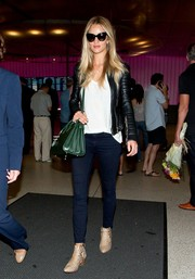 Rosie Huntington-Whiteley put her shapely legs on show in dark blue Frame skinny jeans during a flight to LA.