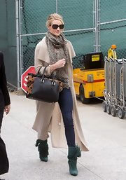 Rosie Huntington-Whiteley amped up the drama with a pair of fringed green mid-calf boots by Isabel Marant.