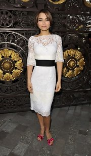 Samantha Barks opted for a romantic and feminine look when she donned this white lace dress with a wide-black waist.
