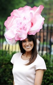 Jackie St. Clair went all out with this oversized single flower topper.