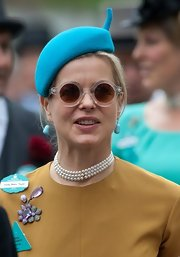 Helen Taylor wore this electric blue beret to bring a pop of color to her tan dress.