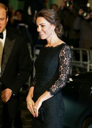 Kate Middleton looked lovely in lace in this floor-length Diane Von Furstenberg black gown.