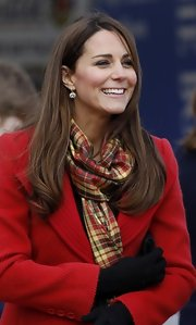 The Duchess of Cambridge showed off her accessorizing skills when she opted for this gorgeous plaid scarf that went perfectly with her red coat.