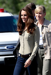 Kate opted for a more casual look, wearing skinny jeans and a neutral-colored button up.