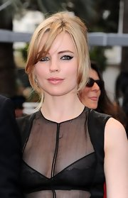 Melissa George styled her hair in a formal French twist while keeping her long bangs loose along with a few face-framing strands.