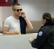 Ryan Gosling looked casually cool in a pair of dark classic wayfarers as he passed by airport security at LAX.