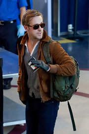 Ryan Gosling hurried through the security gates at LAX with a camo-print backpack slung over his shoulder.