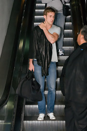 Ryan showed off his ink while arriving at LAX airport.