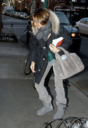 "SJP made a stop at the John Freida salon where she showed off her NYC casual style. She jazzed up her comfy outfit with a coveted grey suede ""Coco Mini' bag."