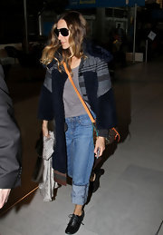 Sarah Jessica Parker covered up in a striped knit duster with cropped swing sleeves.