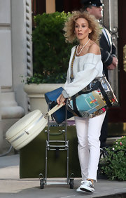 Sarah Jessica Parker is carrying a clear designer duffle.