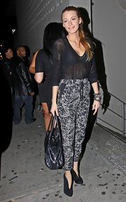 Blake shows her fashion savvy with this daring pair of animal print high-waisted drawstring pants.  Her sheer blouse and black accessories make this all the more fashion forward.