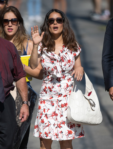 Salma Hayek made her way to 'Kimmel' toting a textured white leather hobo bag by Gucci.