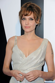 Angelina paired her shimmering silver dress with a loose updo and soft bangs.
