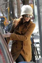 Sandra Bullock keeps her head warm in a white knit beanie while out in the city.