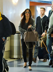 Sanda Bullock looked chic and comfy while traveling through LAX. She paired her taupe satchel with black ballet flats.