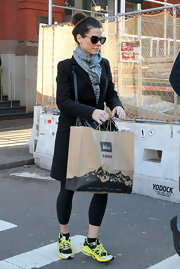Sandra Bullock wore a baby blue plaid scarf with her workout attire while shopping in Soho.