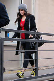 Sandra Bullock stayed warm for shopping wearing a gray knit beanie.