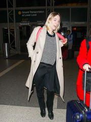 Saoirse Ronan topped off her airport look with a classic trenchcoat.