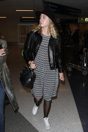 Saoirse Ronan kept it comfy in a loose print dress teamed with a black leather jacket while catching a flight.