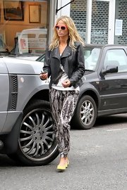 Sarah rocks the season's printed pant trend in this sleek pair with bold tribal details.