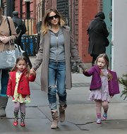Sarah Jessica Parker looked very casual in ripped jeans while walking her daughters to school.
