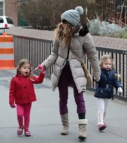 Sarah Jessica Parker kept warm in a knit pom pom beanie.
