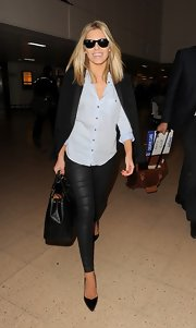 Mollie King is often known for her preppy style, like this baby blue button down.