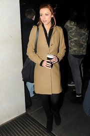 Una Healy kept her look classic and sophisticated with this wool coat in a cool camel color.