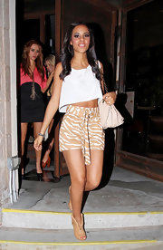 Rochelle Wiseman took a walk on the wild side in a pair of brown zebra print shorts and a loose crop top.