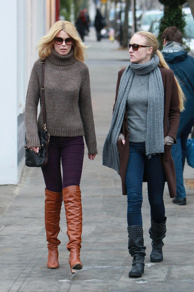 Claudia bundles up in a thick neutral turtleneck while out in London.
