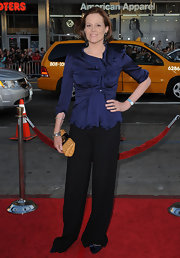 Sigourney paired her classic slacks with a blue satin blouse.