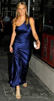 Chelsy Davy shined at the Boodles Boxing Ball in a one shoulder midnight blue crepe satin gown. She finished the look with metallic strappy sandals.
