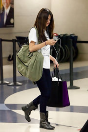 Selena Gomez made her way through LAX carrying an olive canvas tote.