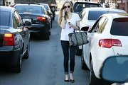 Nope, this isn't a fashion ad. It's just Amanda Seyfried, casually strolling down the street in jeans and a plain white tee.