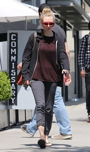 Amanda Seyfried sported a plain zip-up hoodie in a dark charcoal color while out meeting friends.