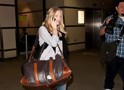 Amanda Seyfried lugged a distressed two-tone brown leather duffel bag at LAX.