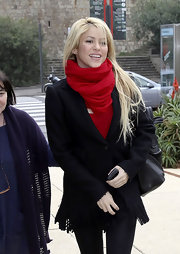 Shakira stays warm in a bold red wrap scarf while out in Tonino.