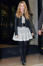 Shakira steps out in sexy lace-up cutout boots while leaving her hotel.