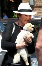 Sharon Osbourne stepped out of her hotel wearing a white hat.