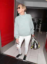 Sharon Stone completed her comfy airport look with a pair of Adidas canvas sneakers.
