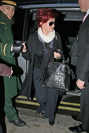 Sharon Osbourne arrived at her London hotel carrying a stitched leather tote.