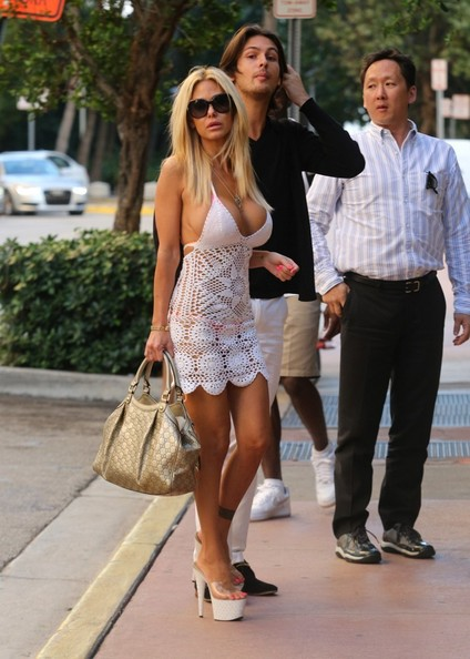 Shauna Sand wowed in Miami Beach with this metallic gold Gucci tote and crocheted dress combo.